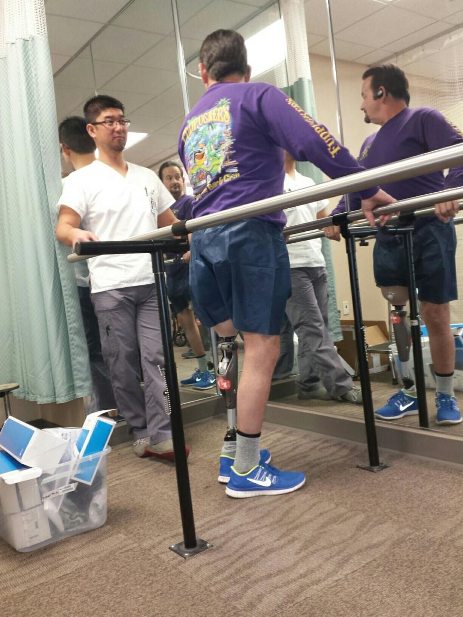 Dennis takes his first steps on his prosthesis